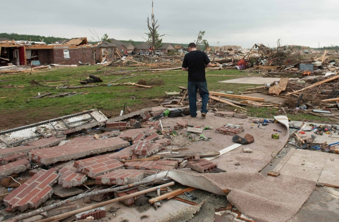 Shawn Riddle reacts while searching through the rubble of his family's home destroyed a day after a tornado hit the town of Vilonia, Arkansas April 28...