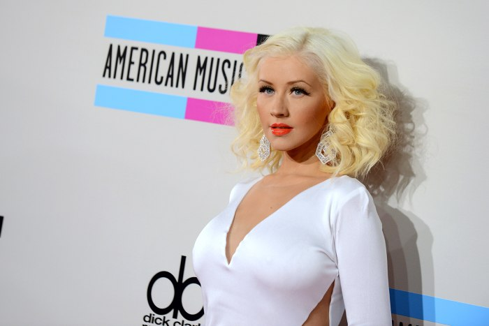FILE - In this Nov. 24, 2013 file photo, Christina Aguilera arrives at the American Music Awards at the Nokia Theatre L.A. Live, in Los Angeles. On Th...