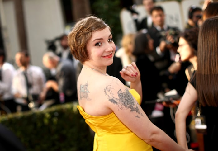 BEVERLY HILLS, CA - JANUARY 12:  71st ANNUAL GOLDEN GLOBE AWARDS -- Pictured: Actress Lena Dunham arrives to the 71st Annual Golden Globe Awards held ...