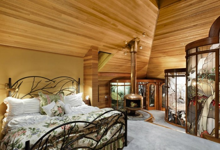 The home's master bedroom features curved stained glass walls.