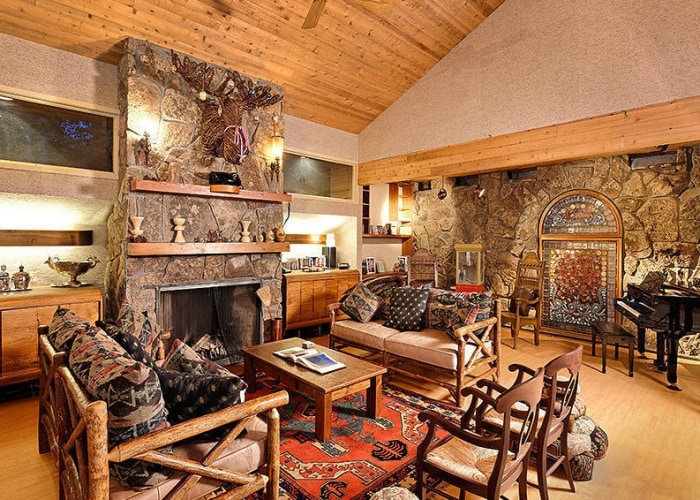 John Denver's former estate in Aspen has four fireplaces indoors and one outdoors.