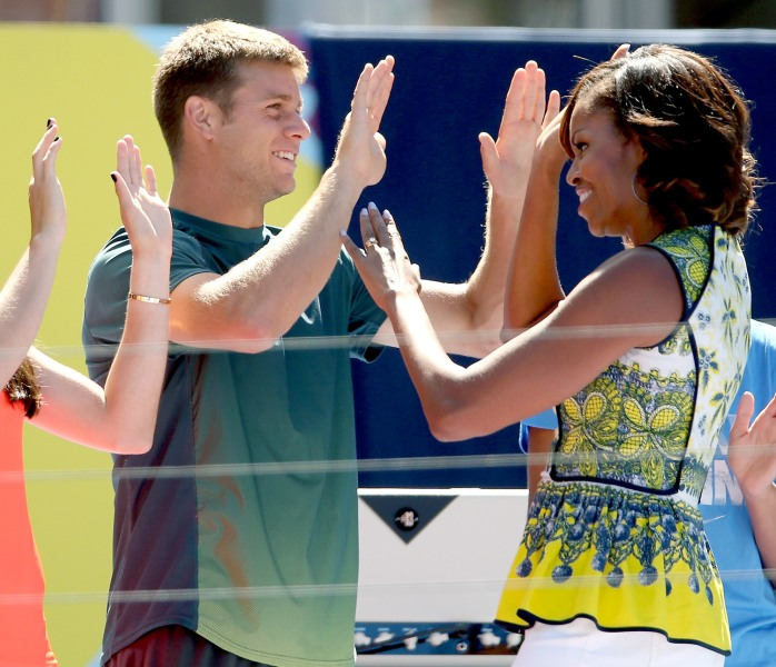 NEW YORK, NY - AUGUST 24:  Christina McHale and Ryan Hsarrison high five with first lady Michelle Obama as she takes the stage to address the crowd ga...
