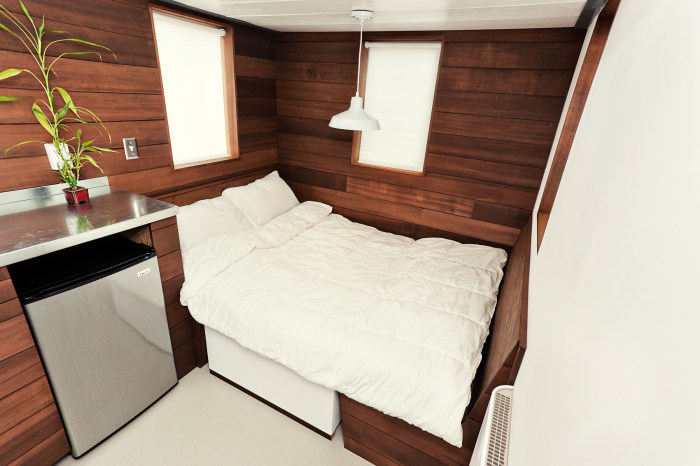 Every inch counts in a tiny house, where a dining room table converts into a bed.