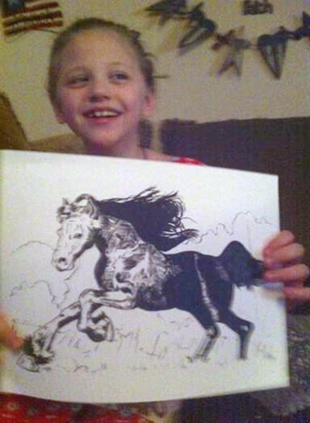 Lex with one of the many horse drawings that have arrived in the mail.