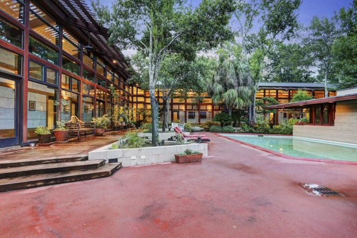 The home's original owner reportedly talked Frank Lloyd Wright out of running the swimming pool into the master bedroom.