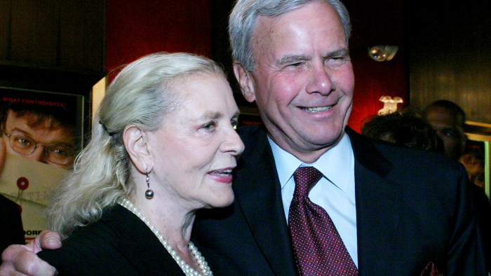 "Lauren Bacall, left, and Tom Brokaw arrive for a special screening of Michael Moore's ""Fahrenheit 9/11"" in 2004 in New York."