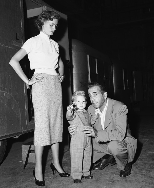 "Stephen Bogart, not yet two years old, learns about movie making from his dad, actor Humphrey Bogart, during a surprise visit to the set of ""Siro..."
