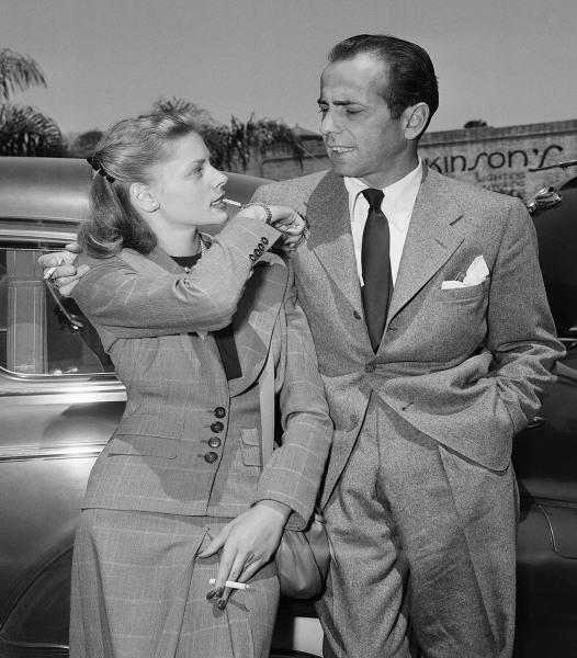 "Actress Lauren Bacall gives a toot on a gold whistle attached to her bracelet to let her new husband, Humphrey Bogart, who calls his wife ""Baby&q..."