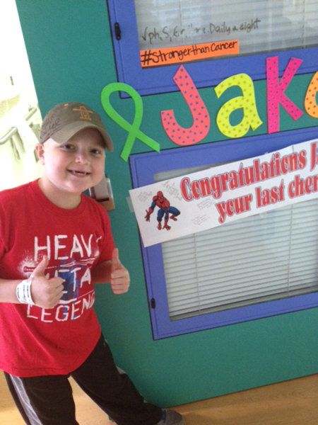 Texans fan Jake Daniel, who was diagnosed with non-Hodgkin's lymphoma in December, celebrates his final round of chemotherapy in May.
