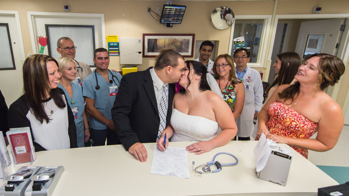 After saying their marriage vows, Lauricella and Mikucki of Holtsville signed their marriage certificate at the nurses station on the oncology/bone marrow unit.