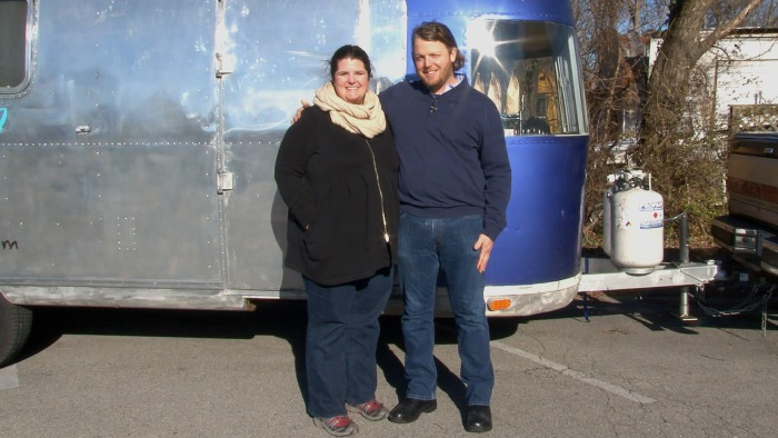 Sarah and Karl Worley pose in front of their small business, the Biscuit Love food truck.