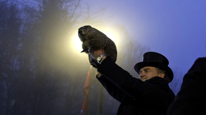 Groundhog handler John Griffiths holds Punxsutawney Phil after he saw his shadow.