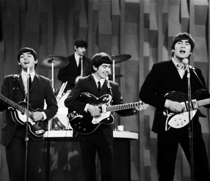 "The Beatles, from left, Paul McCartney, Ringo Starr on drums, George Harrison and John Lennon, perform on the ""The Ed Sullivan Show"" in New York on Feb. 9, 1964."