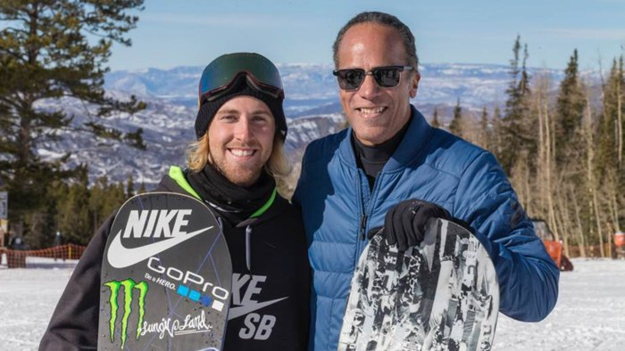 Lester on the slopes of Aspen with snowboarder Sage Kotsenburg.