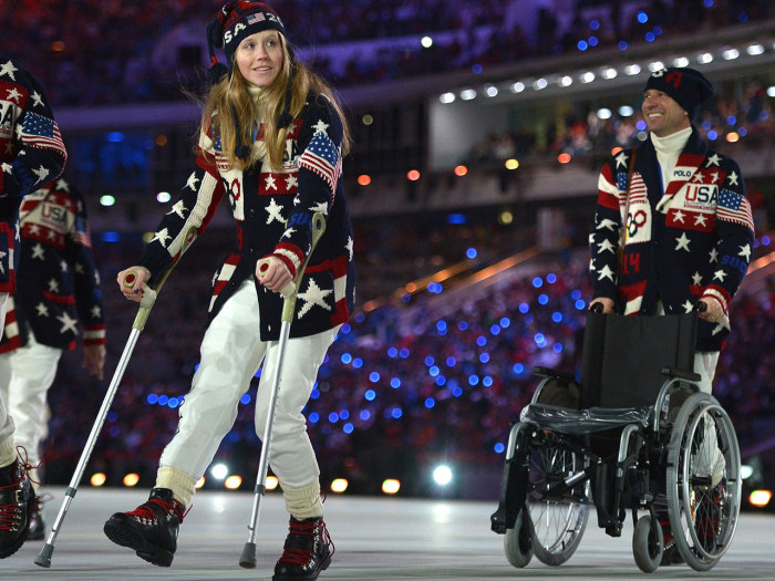 US skier Heidi Kloser walks with crutches as she parades with her delegation during the Opening Ceremony of the Sochi Winter Olympics at the Fisht Oly...