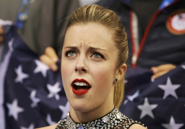 "Ashley Wagner of the United States reacts in the ""kiss and cry"" area during the Team Ladies Short Program at the Sochi 2014 Winter Olympics, February ..."