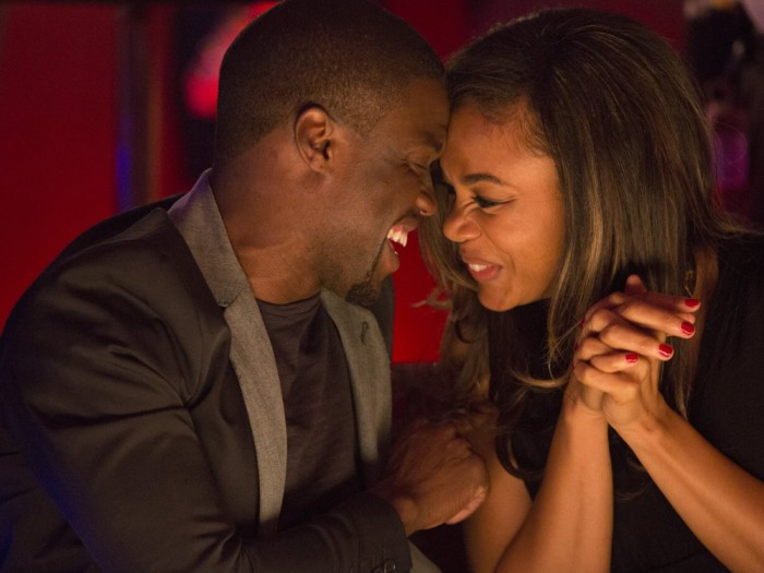"""Bernie (Kevin Hart) and Joan (Regina Hall) drink and flirt on their date in """"About Last Night."""""""