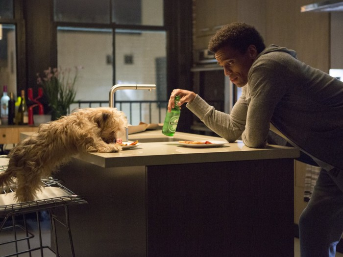 """Danny (Michael Ealy) shares his lonely dinner with his dog Pacino in """"About Last Night."""""""