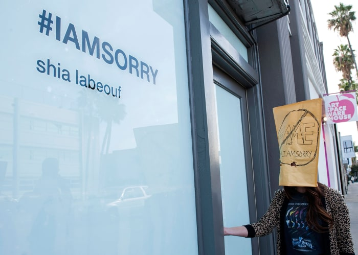 "People line up one-by-one to see Shia LaBeouf's ""I Am Sorry"" art exhibit."
