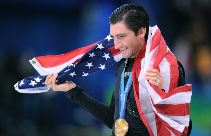 Gold medallist, US Evan Lysacek, does his honour lap after performing in the Men's Figure skating free program at the Pacific Coliseum in Vancouver du...