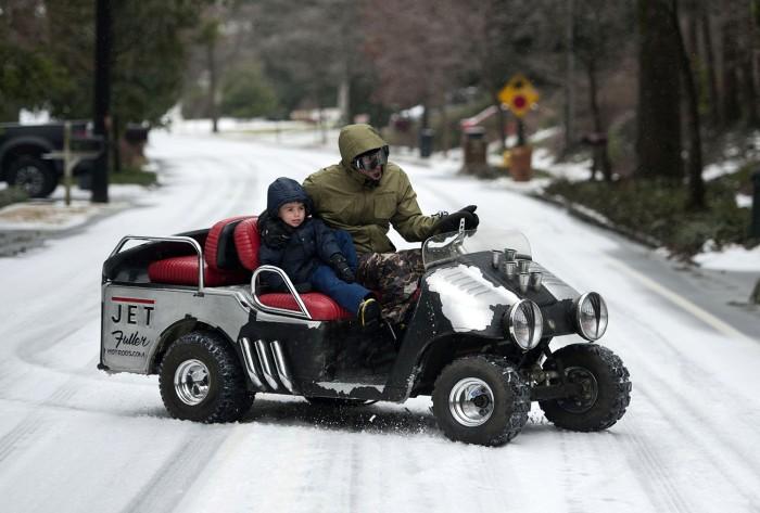 ATLANTA, GA - FEBRUARY 12: Bryan Fuller and his son, Cannon Fuller, tour a Druid Hills neighborhood in their customized golf cart on February 12, 2014...