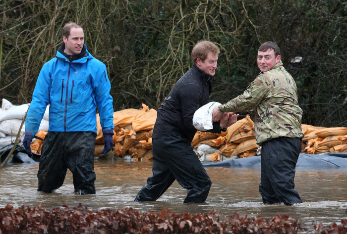 DATCHET, UNITED KINGDOM - FEBRUARY 14:  Prince William, Duke of Cambridge and Prince Harry help with flood defences around Eton End School on February...