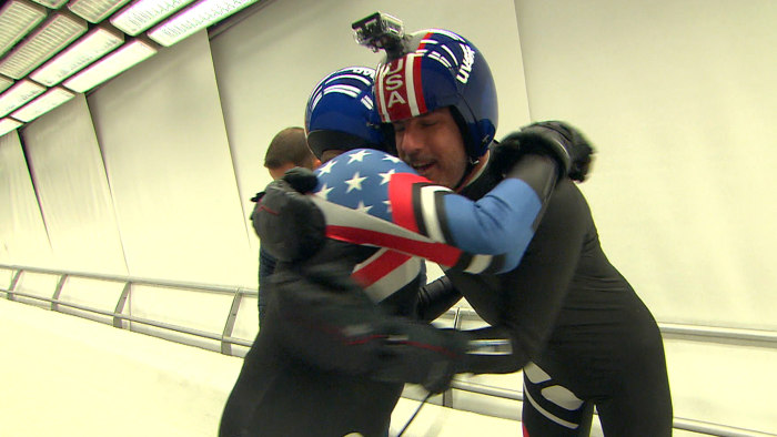 Al Roker and Matt Lauer hug it out after a close call on the luge run.