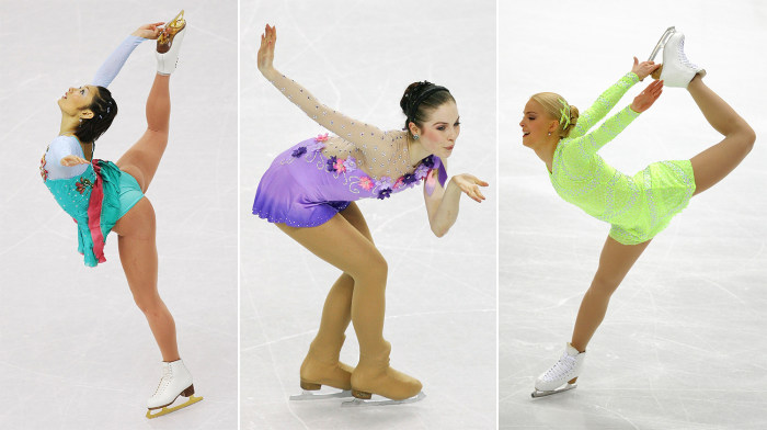 Three female skaters show off their hair accessories at the 2006 Olympics in Turin