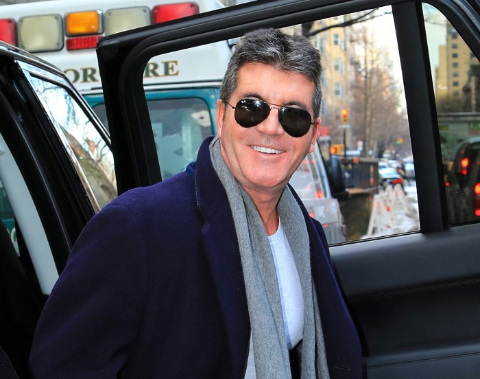 A very happy Simon Cowell is seen arriving at Lenox Hill Hospital on  New York City on Friday to wait for the birth of his son.