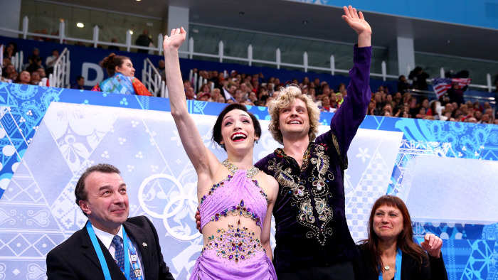 Davis and White wave to fans after competing in the routine that won them gold.