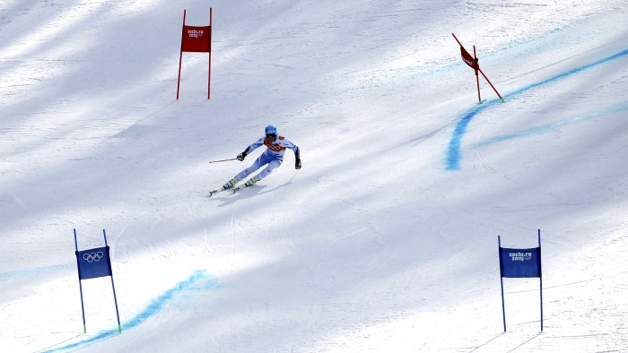 Austria's Matthias Mayer speeds down the course during the second run of the men's alpine skiing giant slalom event at the 2014 Sochi Winter Olympics ...