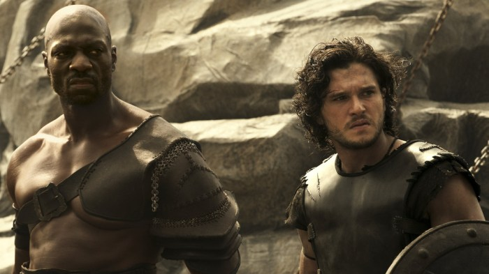 "Atticus (Adewele Akinnouye-Agbaje) and Milo (Kit Harington) in ""Pompeii."""