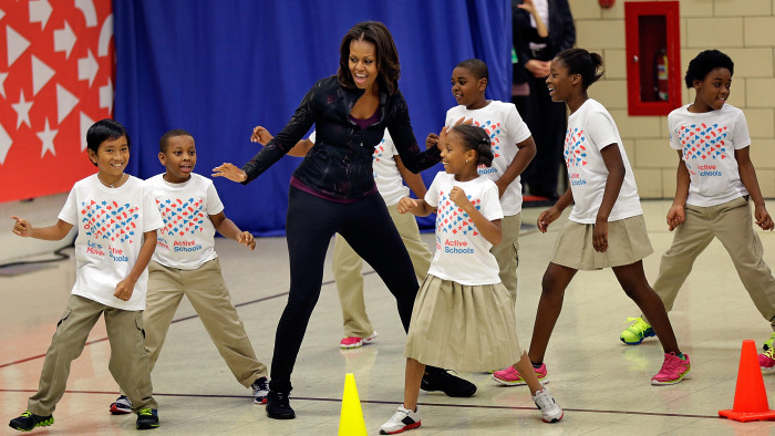 WASHINGTON, DC - SEPTEMBER 06: U.S. first lady Michelle Obama exercises with schoolchildren at Orr Elementary School as part of a ''Let's Move! Active...
