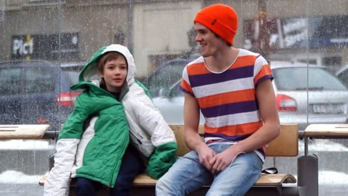 In the video SOS Mayday, strangers give up their jackets to a shivering kid on a freezing, wet day in Norway.
