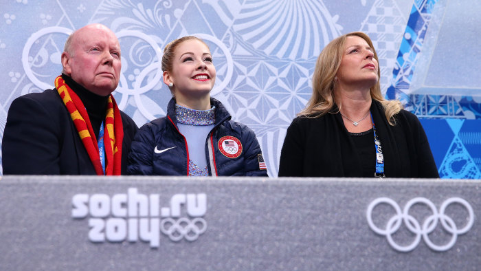 Gracie Gold (center) waits for her score with her coach Frank Carroll
