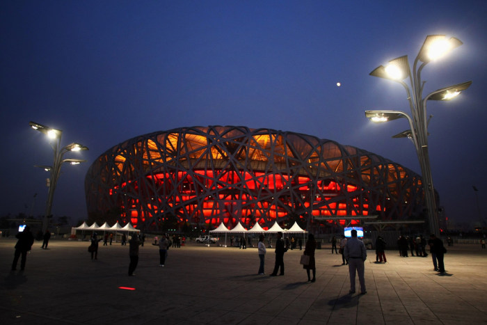"BEIJING - DECEMBER 10:  Crowds of tourists visit the National Stadium, known as the ""Bird's Nest"",on December 10, 2008 in Beijing, China. The Bird's N..."