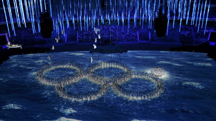 Performers form the Olympic rings during the Closing Ceremony for the 2014 Sochi Winter Olympics, but not without a little joke first.