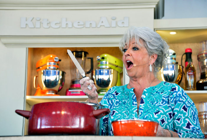During a cooking demonstration, Paula Deen apologized to a gathered crowd at the South Beach Wine & Food Festival on Sunday in Miami.