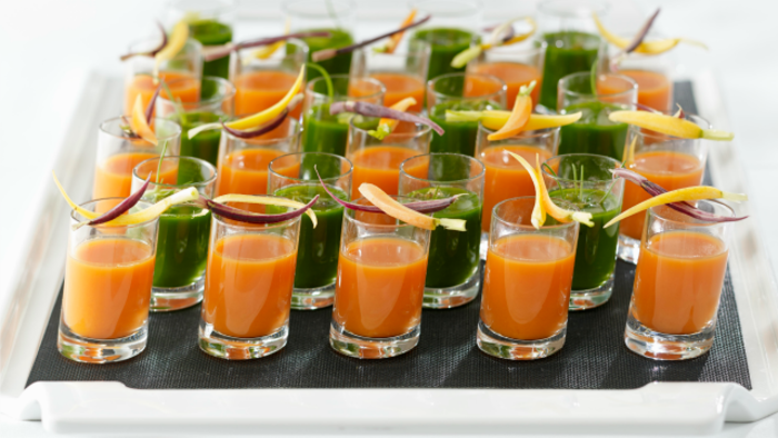 Chef Wolfgang Puck's Power Smoothie Shots (the green liquid pictured above) can be made in a blender or juicer and are a refreshing way to kick off your party.