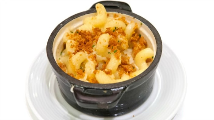 Though the dish is ingredient-heavy, Puck's mac and cheese with truffles is worth the effort.