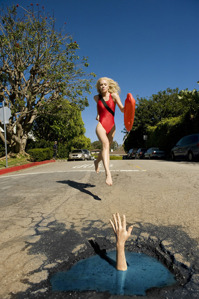 Image: Baywatch recreated with a pothole instead of an ocean
