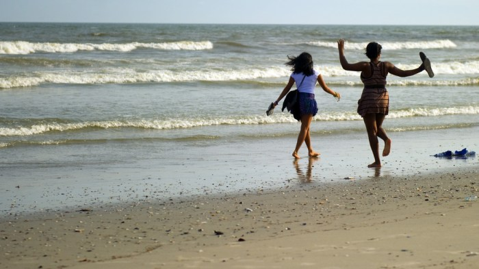 Tourists run on the beach near casinos in Atlantic City
