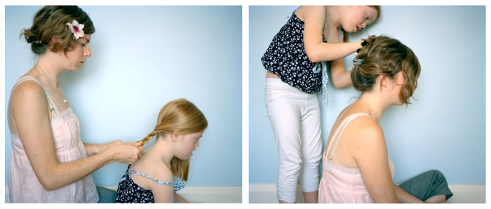 The mother-daughter photo project captures simple moments, like the pair doing each other's hair (here in 2011).