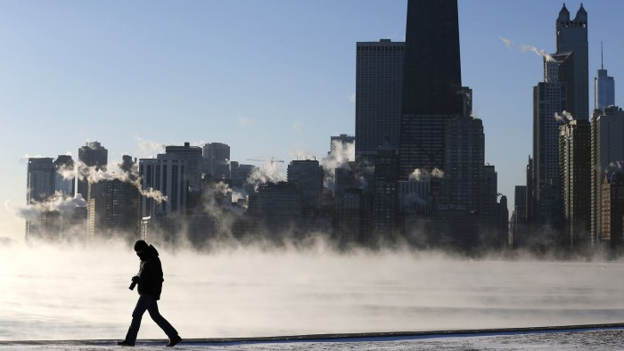 A man is silhouetted against the arctic sea smoke rising off Lake Michigan in Chicago, Illinois January 6, 2014. A blast of Arctic air gripped the mid...