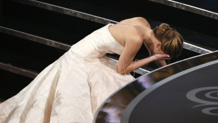 "Actress Jennifer Lawrence falls as she walks up the steps to accept the award for best actress for her role in ""Silver Linings Playbook"" at the 85th A..."