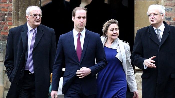 Britain's Prince William, Duke of Cambridge, (2L) arrives at  St John's College, Cambridge, alongside Leszek Borysiewicz (L) Vice Chancellor Universit...