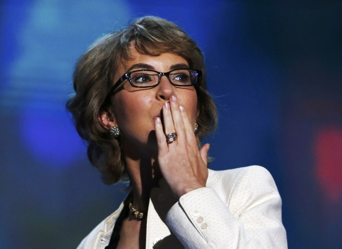 Former Rep. Gabrielle Giffords (D-AZ) blows a kiss after reciting the Pledge of Allegiance during the final session of the Democratic National Convent...
