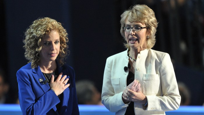 Chair of the Democratic National Committee Debbie Wasserman Schultz (L) and former congresswoman Gabrielle Giffords deliver the Pledge of Allegiance a...