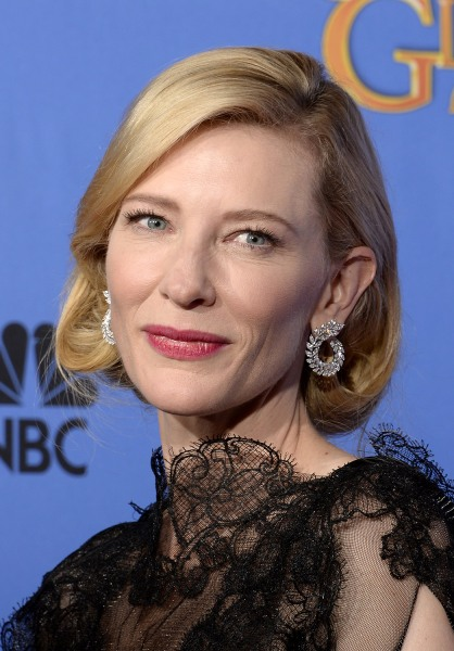 BEVERLY HILLS, CA - JANUARY 12:  71st ANNUAL GOLDEN GLOBE AWARDS -- Pictured: Actress Cate Blanchett poses with her award for Best Performance by an A...