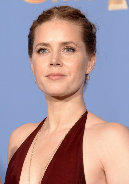 BEVERLY HILLS, CA - JANUARY 12:  Actress Amy Adams, winner of Best Actress in a Motion Picture - Musical or Comedy for 'American Hustle,' poses in the...
